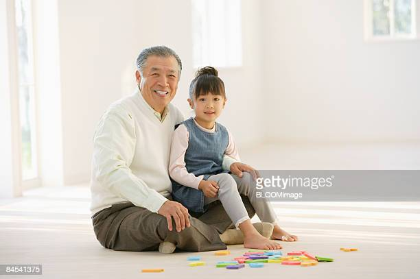 Girl and grandfather, portrait