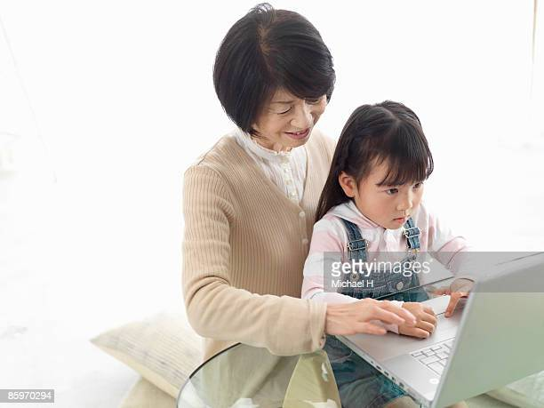 Girl and grandma who does personal computer