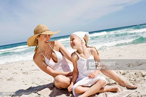 girl and her mother on the beach