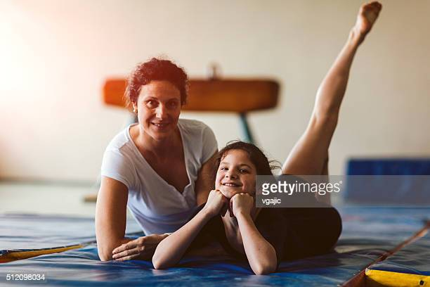 Girl And Her Mother Posing In Gym