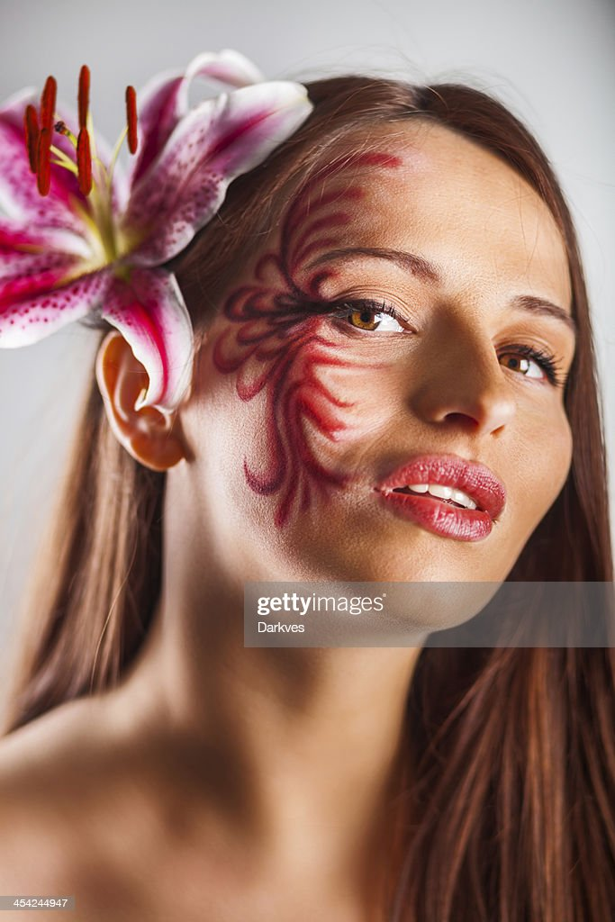 Girl and lily : Stock Photo