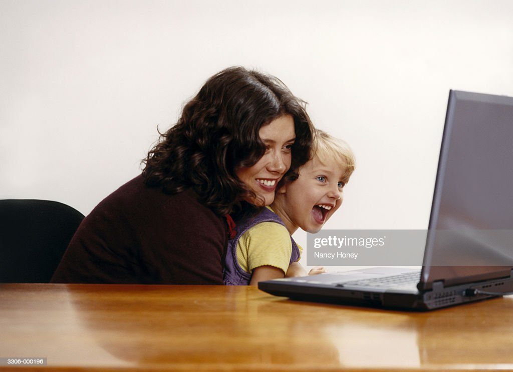 Girl and Mother with Laptop : Stock Photo