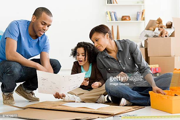 Girl and parents building furniture