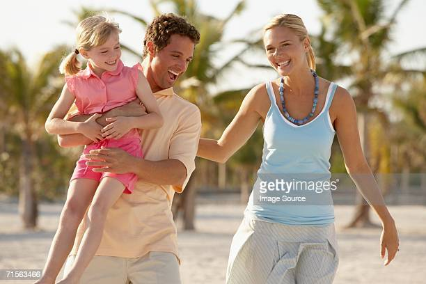 Girl and parents having fun