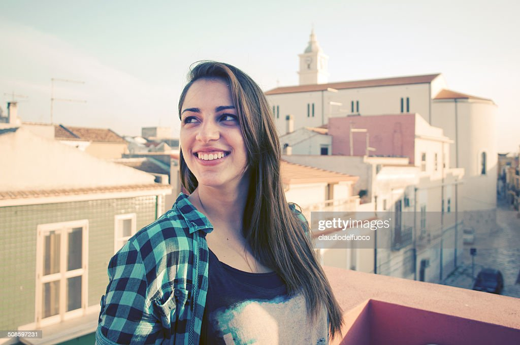 Girl and roofs : Stock-Foto