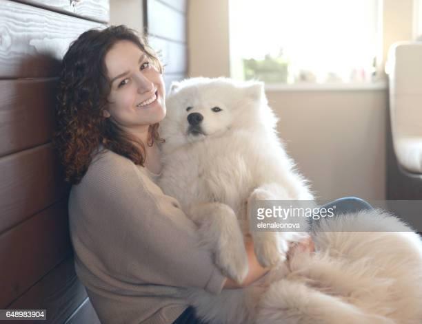 Girl and Samoyed dog