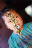 Girl and Skewered Grasshoppers