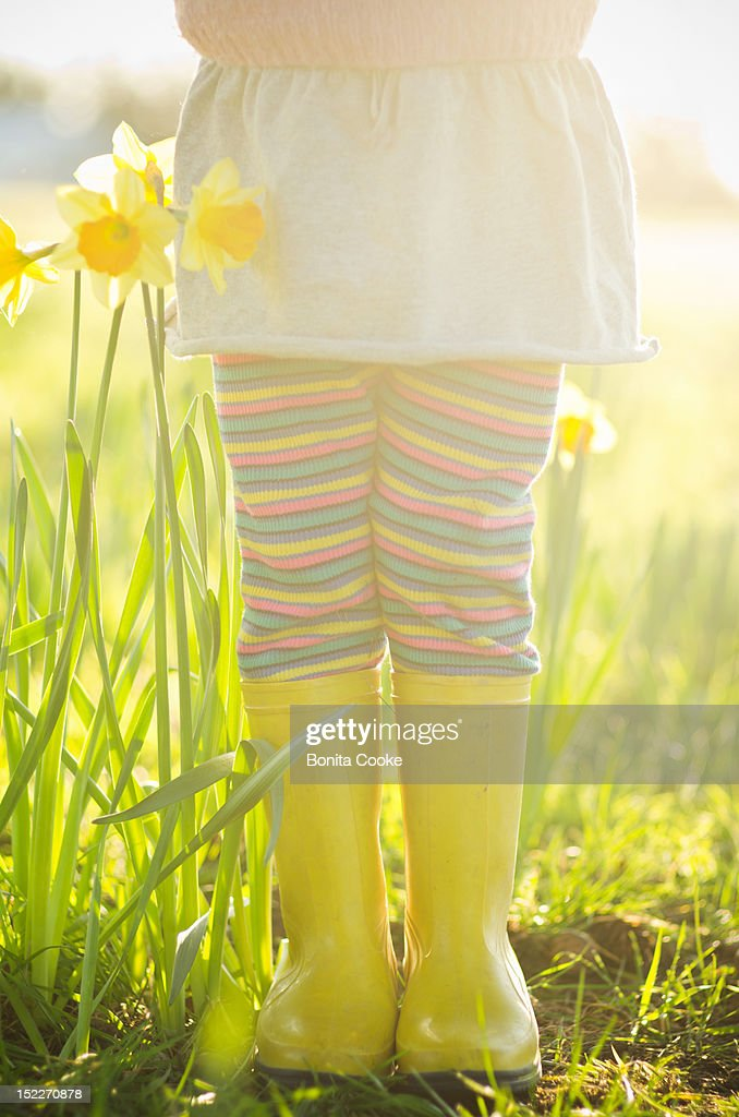 Girl and spring daffodil flowers : Stock Photo