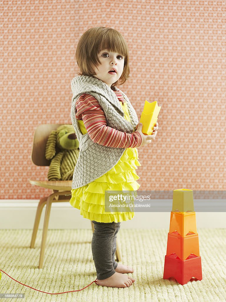 Girl and Stacking Toy : Stock Photo