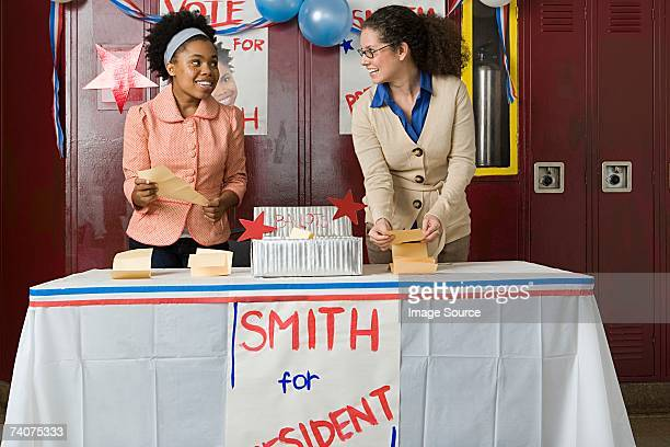 Girl and teacher counting votes
