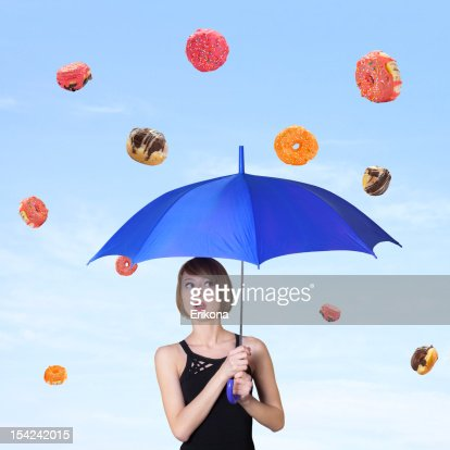 Girl and the falling donuts : Stock Photo