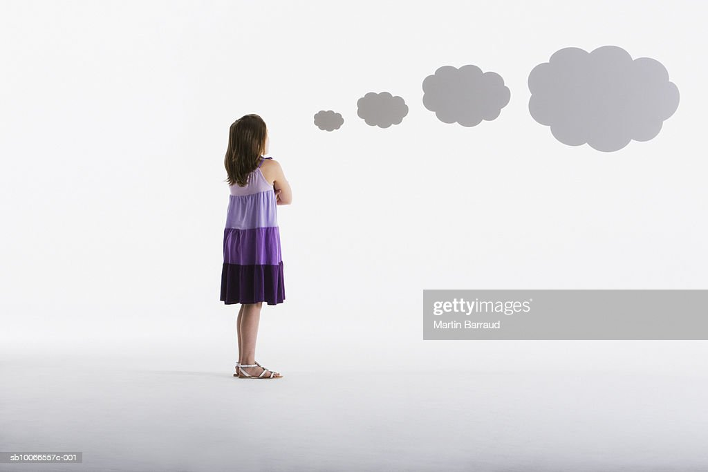 Girl (8-9) and thought bubbles on white background : Stock Photo