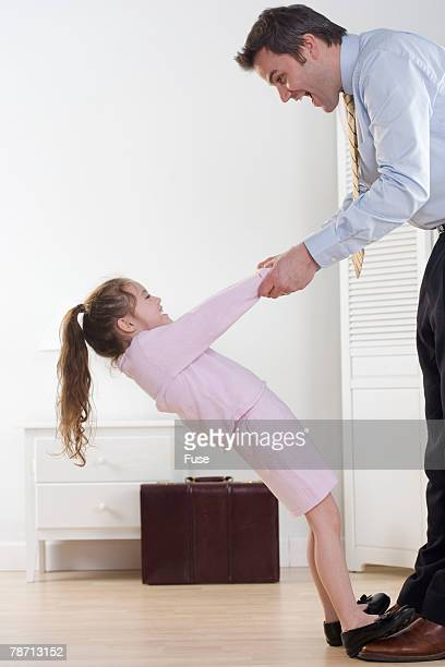Girl and Working Father Holding Hands