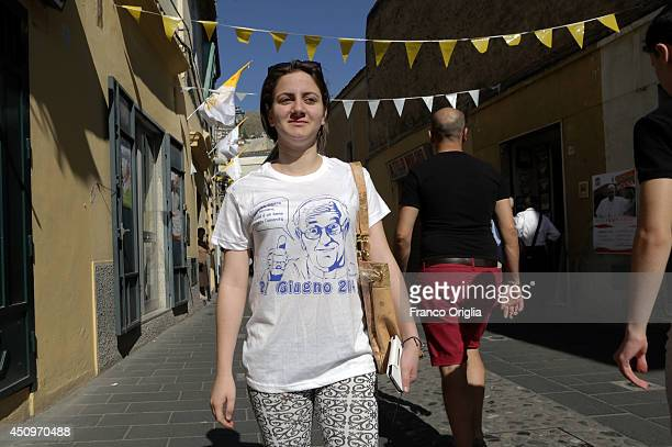 A girl arrives at the Cassano's Cathedral for the Pope Francis' arrival on June 21 2014 in Cassano allo Jonio Cosenza Italy Pope Francis is visiting...
