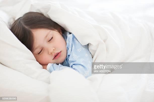 Girl asleep in bed