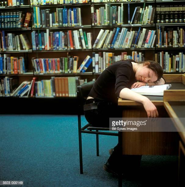 Girl Asleep in Library