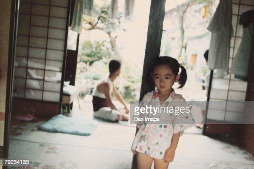 Girl at home in pajamas : Stock Photo