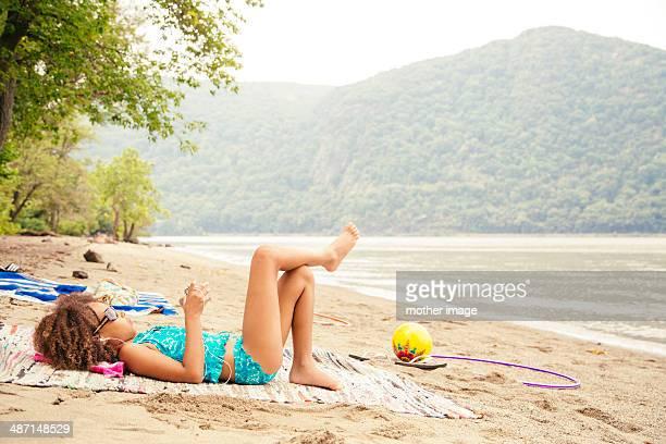 Girl at lake watching video