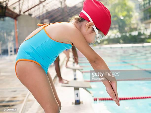 Girl at starting block for swimming race