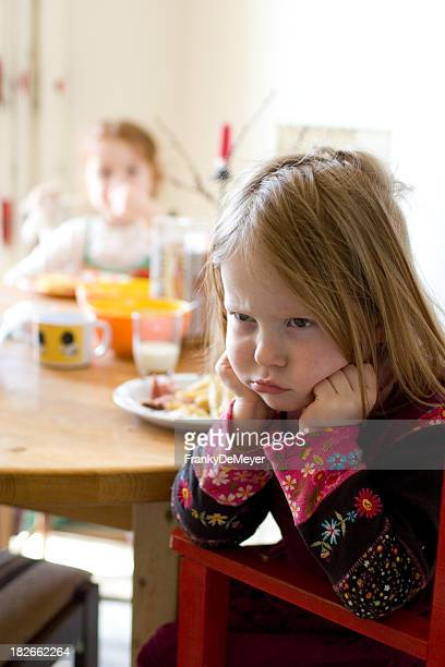 girl at table, doesn't want to eat