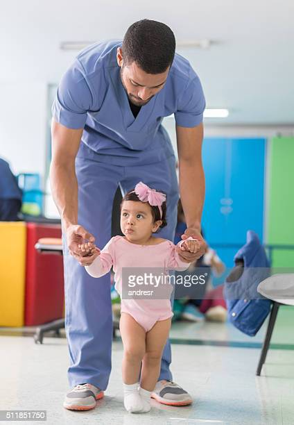Girl at the hospital in early stimulation therapy