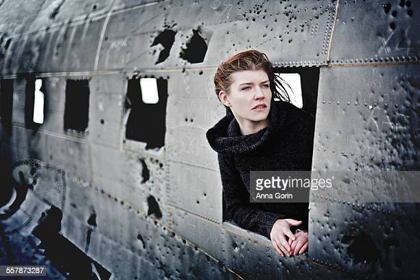 Girl at window of battered plane crash