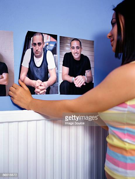 Girl attaching posters to wall