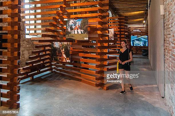 A girl attends at the Argentina Pavillion of the 15th Architecture Venice Biennale on May 27 2016 in Venice Italy The 15th International Architecture...