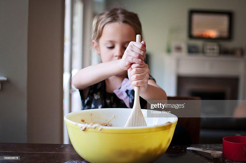 Girl Baking and Mixing : Stock Photo