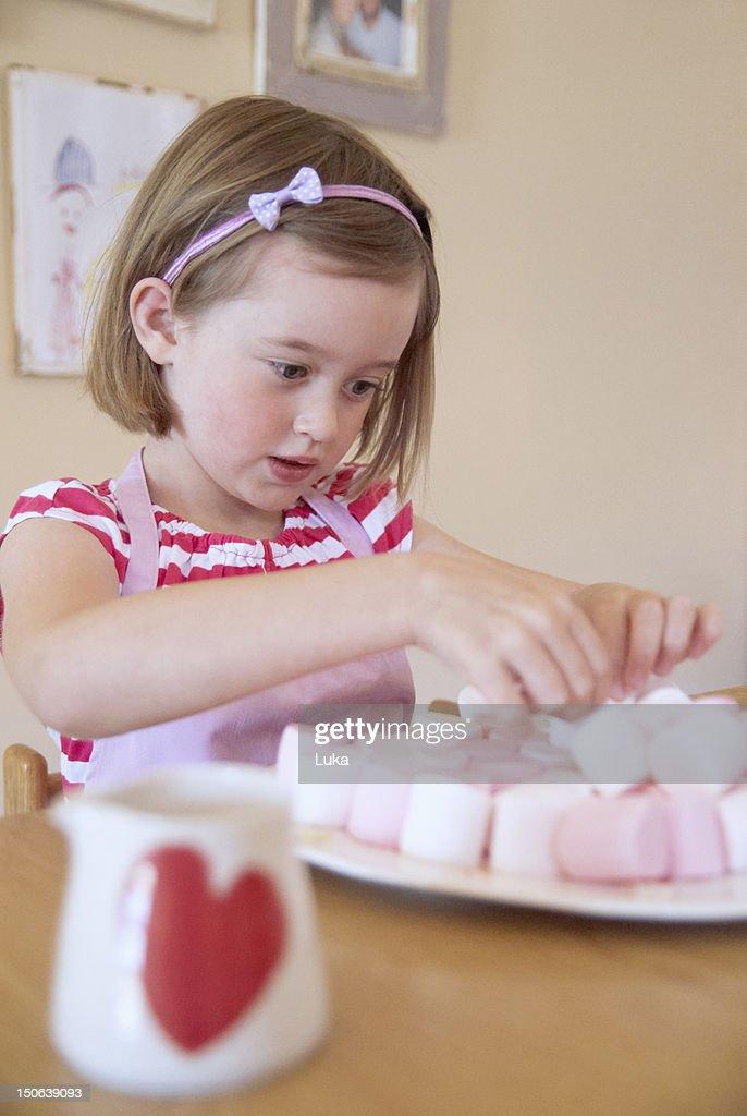 Girl baking in kitchen : Stock Photo
