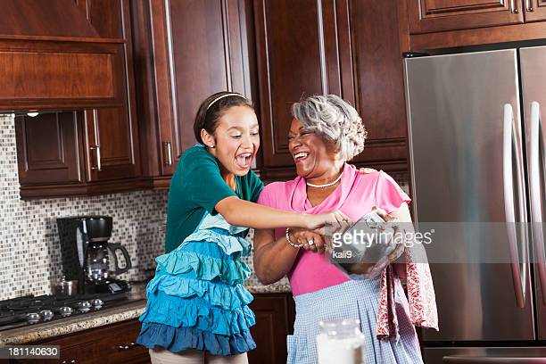 Girl baking with grandmother