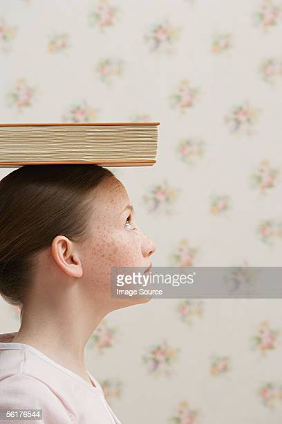 Girl balancing a book on her head