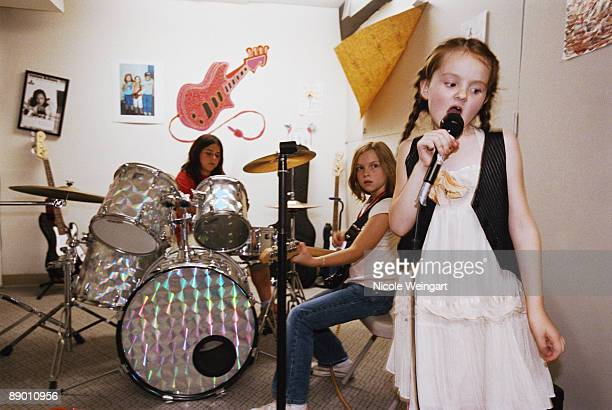 Girl band practicing together