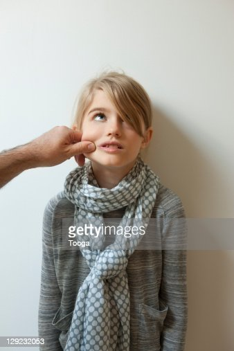 Girl being pinched on the cheek by dad : Stock Photo