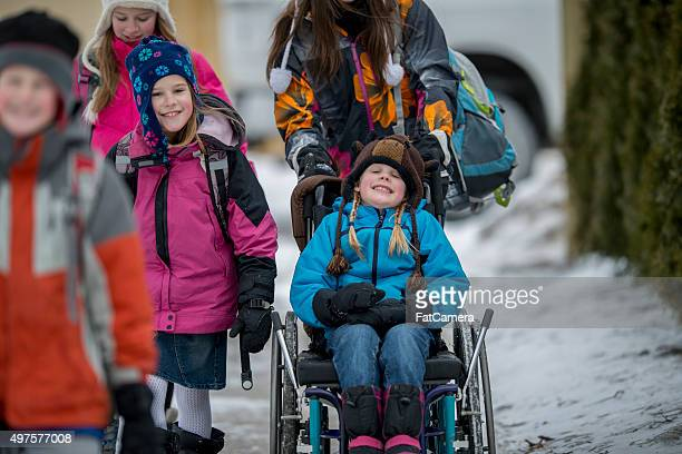 Girl Being Pushed in a Wheelchair