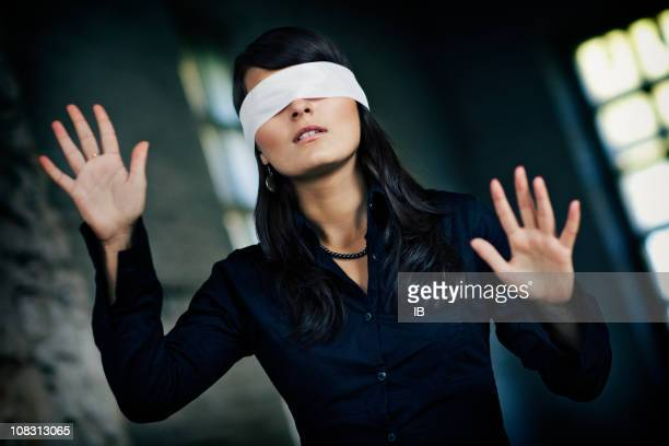 Girl blindfolded goes by feel