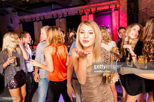 Girl blowing a kiss at party