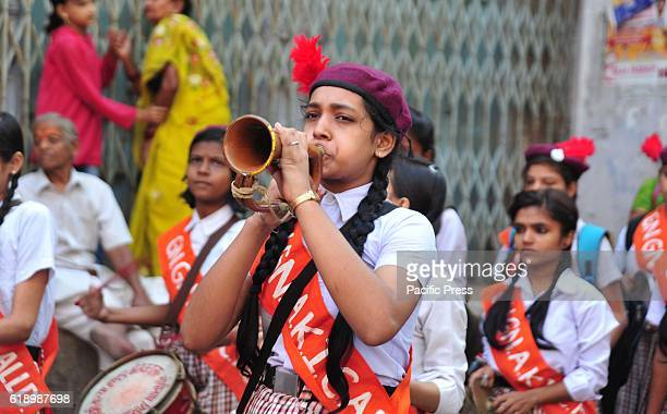 A girl blowing Bighul during take part in a religious procession as part of the Hindu festival of Hanuman Jayanti in Allahabad Hanuman Jayanti...