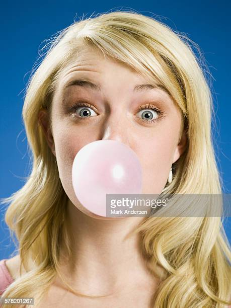 Girl blowing bubble and cross eyed