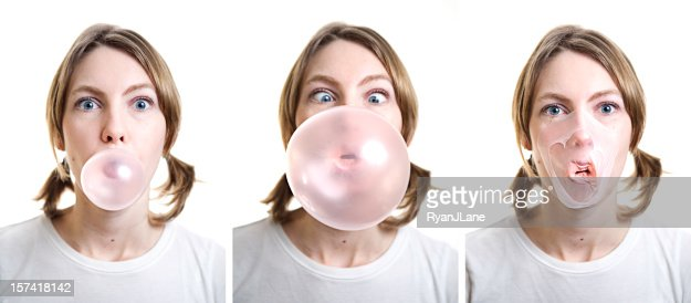 Girl Blowing Bubble Gum which Pops on Her Face