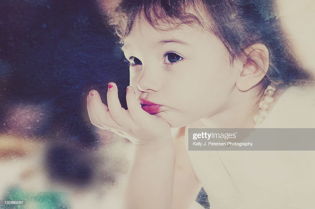 Girl blowing kisses : Stock Photo