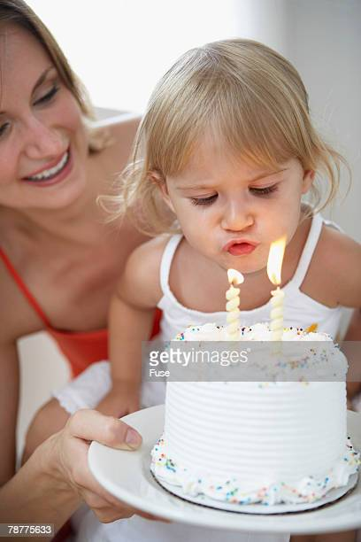 Girl Blowing Out Candle