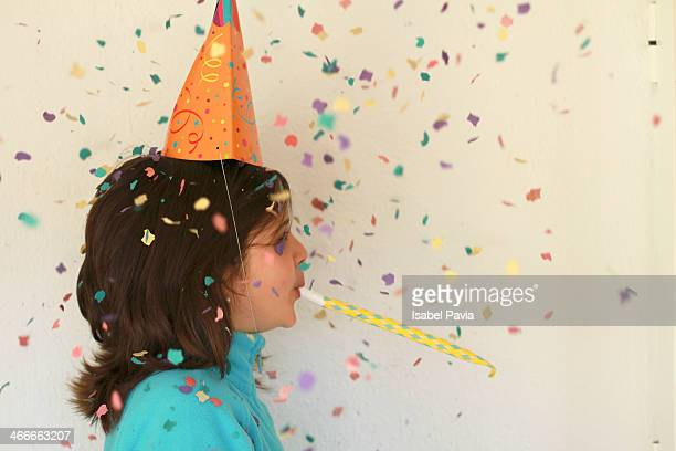Girl blowing party horn