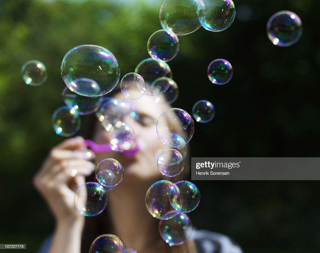 girl blowing soapbubbles : Stock Photo