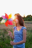 Girl blowing toy windmill