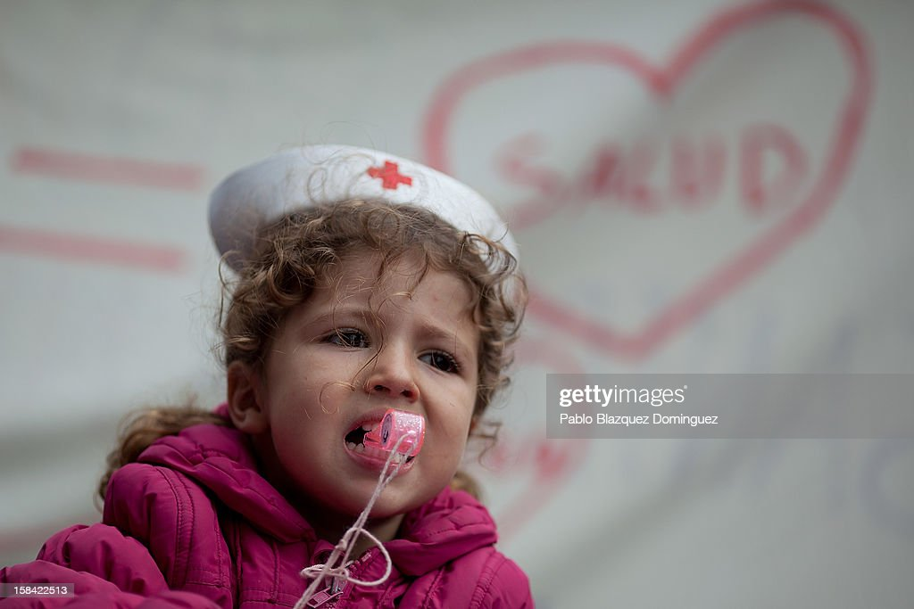 A girl blows the whistle amid other health workers during a demonstration against cuts on public health care and the privatization of medical centers and hospitals on December 16, 2012 in Madrid, Spain. In Madrid, doctors have already staged 11 days of strikes and all health workers unions are calling for a third 48 hour strike on December 19 and December 20. Around 4,000 operations have been suspended in Madrid since the medical strikes started.