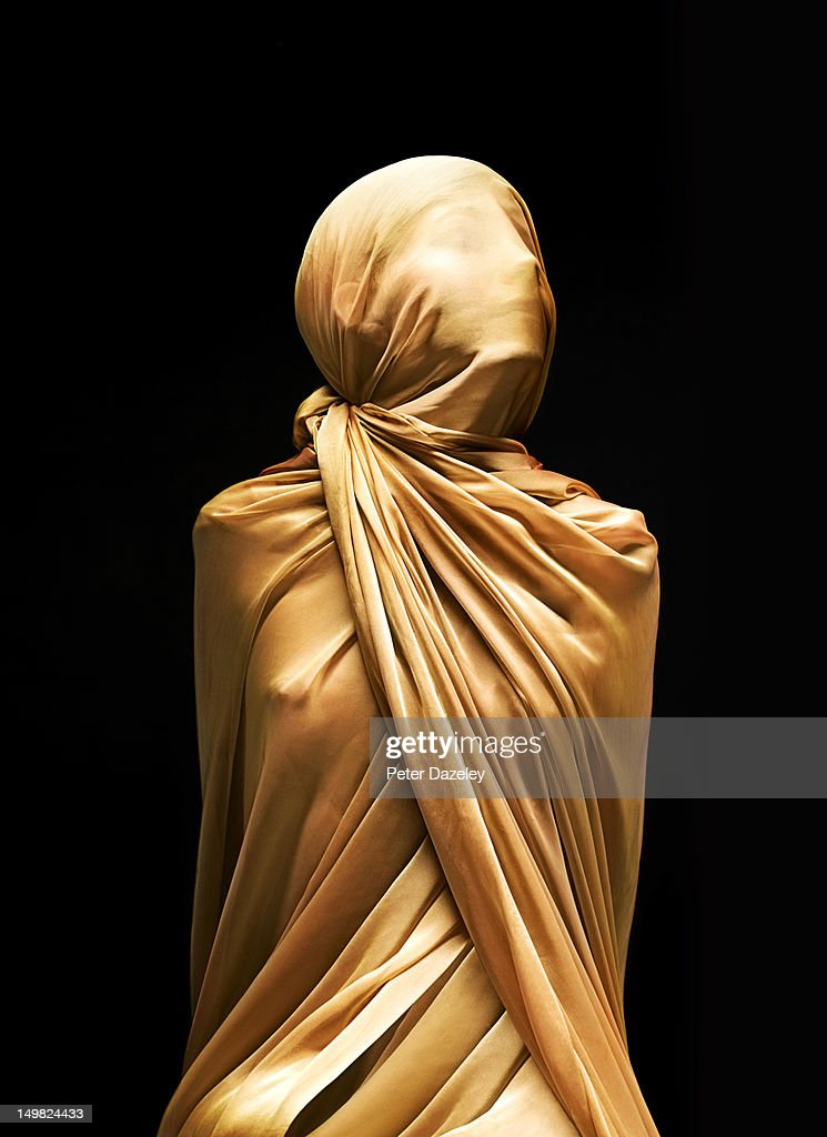 Girl bound/covered in silk : Stock Photo