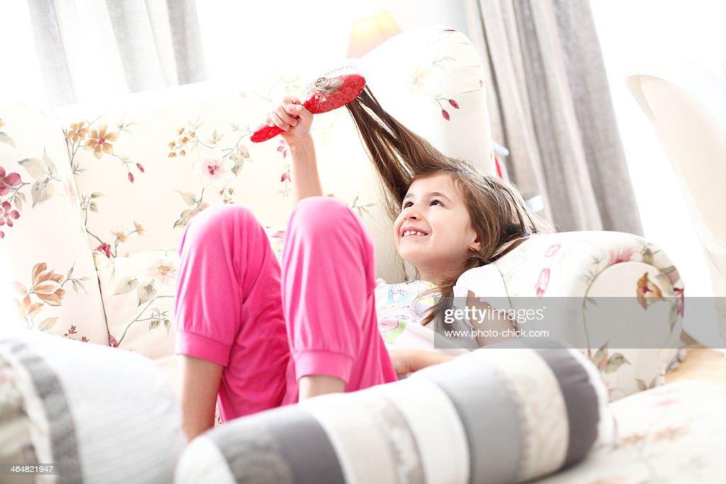 A girl brushing her hair