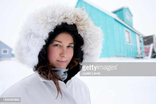 Girl bundled in fur hood in the snowy arctic : Stock Photo