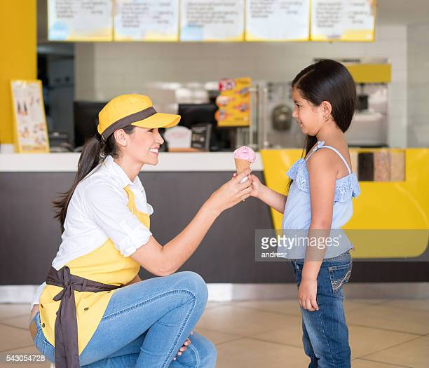 Girl buying a cone at an ice cream shop